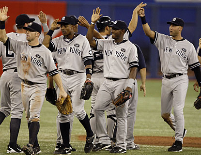 The Yankees get to celebrate a little as they reach the playoffs for the 15th time in the last 16 years. (Getty Images)
