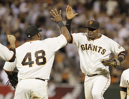 Pablo Sandoval and Juan Uribe, who contribute key hits in San Francisco's comeback, celebrate another Giants victory.  (AP)