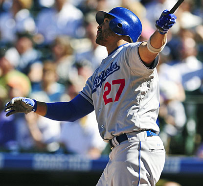 Looks like Matt Kemp knows this swing takes the ball out of the park. And it is, for a grand slam. (US Presswire)