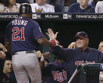 Delmon Young is congratulated by Twins manager Ron Gardenhire after hitting the go-ahead home run in the seventh inning.  (AP)