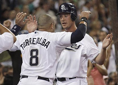 San Diego's Ryan Ludwick is greeted by Yorvit Torrealba after scoring from third on a wild pitch in the fourth inning.  (AP)