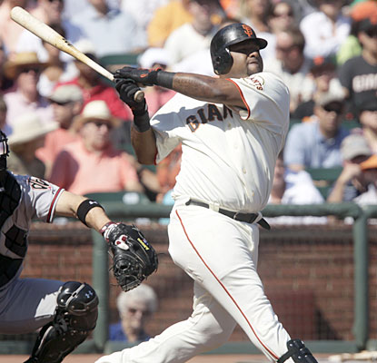 Pablo Sandoval hits a solo shot that lands in McCovey Cove as the Giants win their fourth straight. (AP)