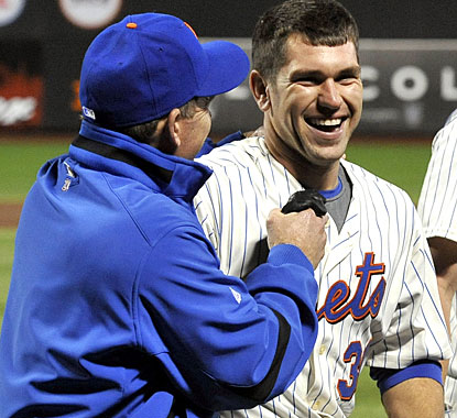 Batting coach Howard Johnson is quite satisfied with Josh Thole, whose solo homer gets the win for the Mets. (AP)