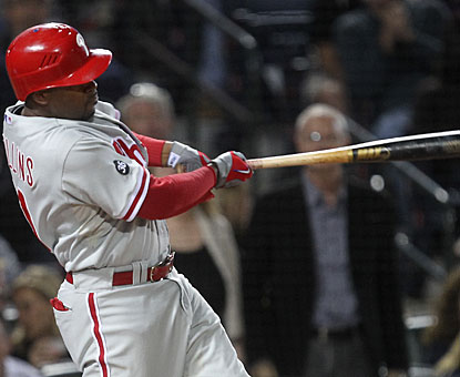Jimmy Rollins caps a five-run spurt in the sixth inning with this grand slam home run (8). (AP)