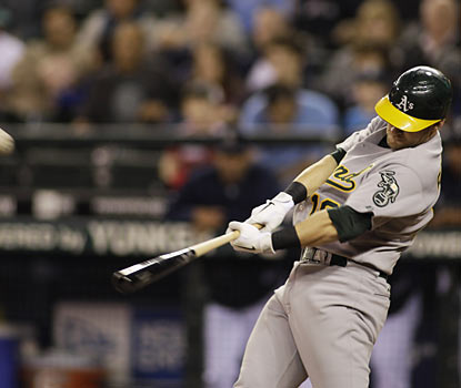 Athletics 1B Daric Barton connects on a pair of home runs -- including a grand slam -- in his first two at-bats.  (AP)