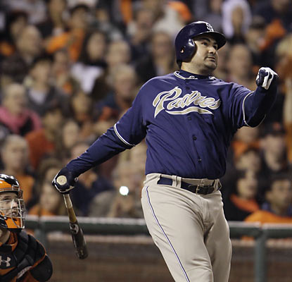 Adrian Gonzalez goes yard and drives in three, helping him surpass 30 home runs and 100 RBI on the season. (AP)