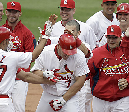 Matt Holliday is mobbed by his teammates after hitting a walk-off RBI single in the 11th inning (AP)