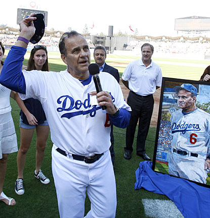 'I guess that last out sort of makes things pretty definite,' Joe Torre says after his final game.  (AP)
