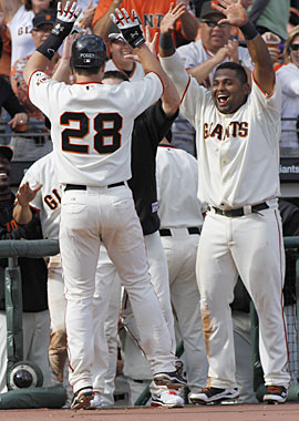 Clutch hitting and solid pitching help the Giants punch their ticket to the playoffs. (AP)