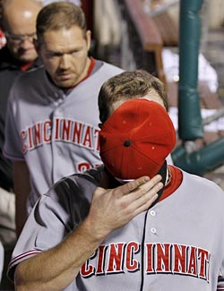 Jay Bruce tries to hide after his mistake proves too costly for the Reds to overcome. (AP)