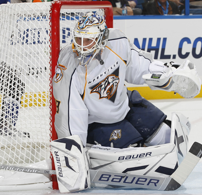 Anders Lindback hugs the post during his 42-save performance to keep Nashville without a regulation loss.  (Getty Images)