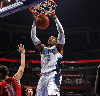 The Magic's Dwight Howard finishes the game against the Nets 9 for 13 with 30 points and 16 rebounds. (US Presswire)
