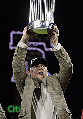In 2008, as general manager of the Phillies, Pat Gillick hoists the World Series trophy after Philly beat Tampa Bay in five. (AP)