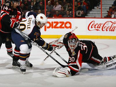 Bryan Little stuffs a rebound past a sprawling Brian Elliott for his first of two goals in the game.  (Getty Images)