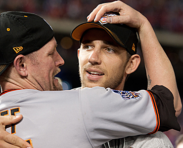 Pitcher Madison Bumgarner (right) played a key role in helping the Giants win the World Series. (Getty Images)