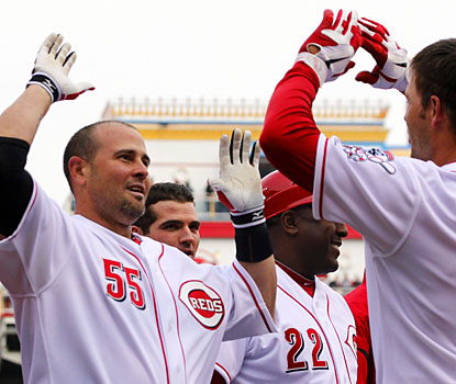 Cincinnati's Ramon Hernandez (55) high-fives Chris Heisey after hitting a walk-off homer. (AP)