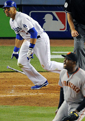 Giants pitcher Santiago Casilla watches James Loney's RBI double in the eighth inning. (AP)