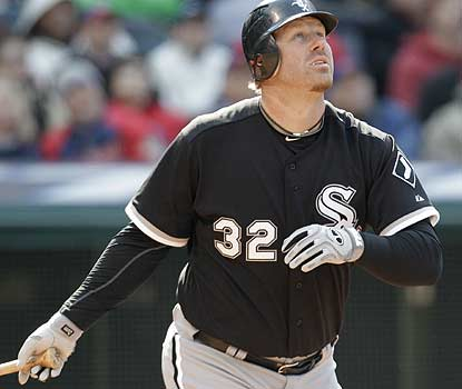 Newcomer Adam Dunn hits a two-run homer in the third to help the White Sox jump out to a 6-0 lead en route to the victory. (AP)