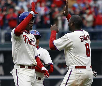 Pinch-hitter John Mayberry Jr. is the hero in the Phillies' opener, driving in the winner with an RBI single. (AP)