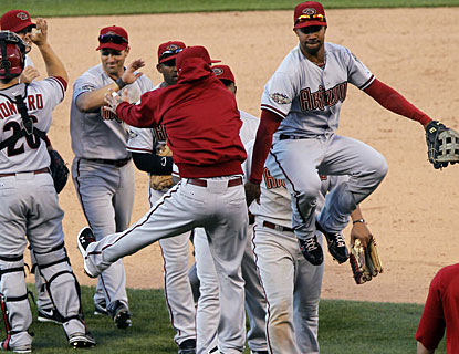 Chris Young (right) and his Diamondbacks teammates jump for joy after starting off the season with a victory. (AP)