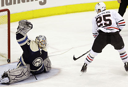 Mathieu Garon makes a good effort, but Viktor Stalberg finds just enough space to slide the puck inside the post. (AP)