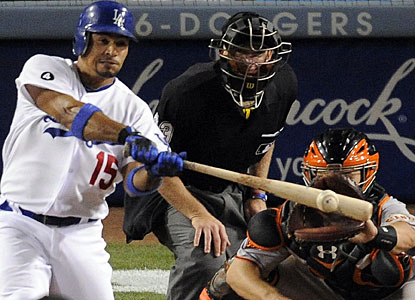 Rafael Furcal connects with the single that drives in three runs for Dodgers in the sixth inning. (AP)