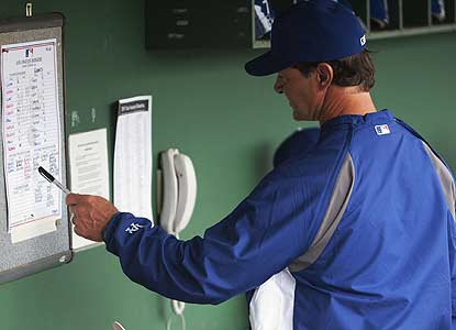 First-time manager Don Mattingly would rather pore over a lineup card than save one from his first game. (US Presswire)