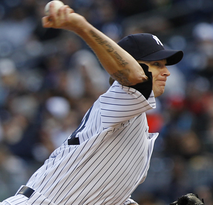 A.J. Burnett is solid in his first outing for the Yankees this season, pitching five innings and allowing three runs. (AP)