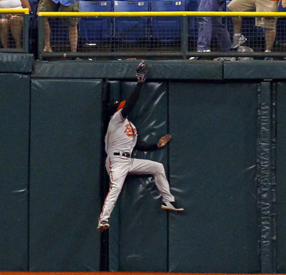 Nick Markakis makes a leaping catch in right field for the final out as the Orioles beat the Rays. (AP)