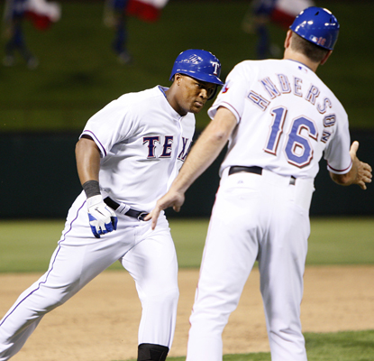 Adrian Beltre gets some love from third base coach David Anderson as he rounds the bases after hitting a grand slam. (AP)