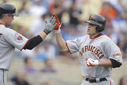 Freddy Sanchez lends a hand in the Giants' rout over the Dodgers by clubbing his first home run of the season.  (AP)
