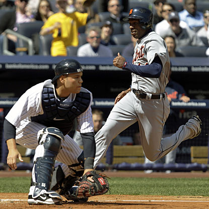 Detroit's Austin Jackson scores on Brennan Boesch's third-inning RBI single. (AP)