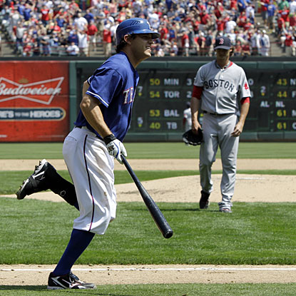 Texas' Ian Kinsler has one at-bat and makes it count with a solo HR off Boston's Clay Buchholz. (AP)