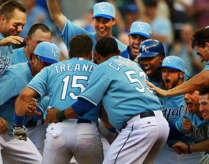 Kansas City's Matt Treanor is greeted at home after hitting a walk-off home run in the 13th inning. (AP)