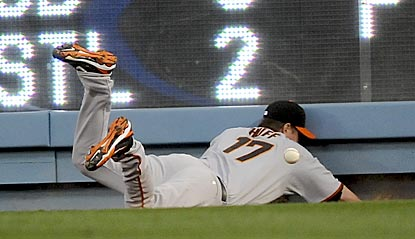 Aubrey Huff's difficulties playing right field -- like here on Marcus Thames' triple in the seventh inning -- help L.A. win.  (AP)