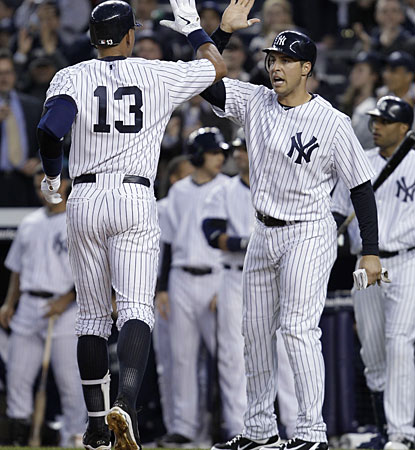 Mark Teixeira congratulates Alex Rodriguez (13) after Rodriguez hits a first-inning, two-run homer. (AP)