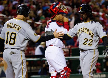 Andrew McCutchen (right) is congratulated by Neil Walker after hitting a two run homer in the sixth off the Cards' Kyle Lohse. (Getty Images)