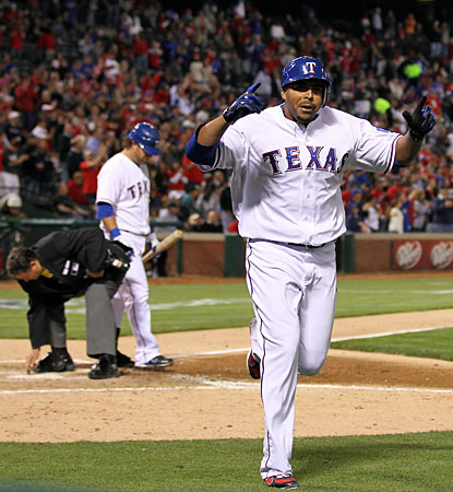 Nelson Cruz runs the bases after hitting his fourth home run in four straight games. (US Presswire)