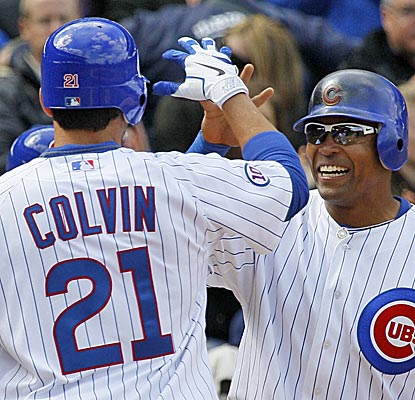 Marlon Byrd (right) welcomes home Tyler Colvin after Colvin's third-inning, two run dinger plates both in the Cubs' 6-5 win. (AP)