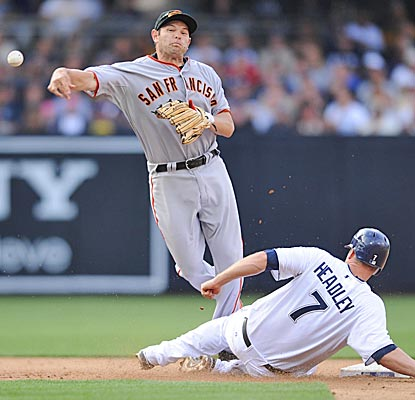 Chase Headley slides into Freddy Sanchez to break up a double play, and the Padres hold off the Giants for a 3-1 win.  (US Presswire)