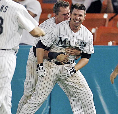 Logan Morrison bear-hugs Donnie Murphy after Murphy drives in the winning run in the 10th inning to beat the Nats.  (AP)