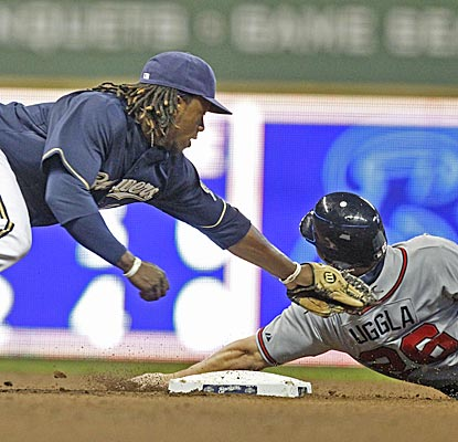 Rickie Weeks tags out Dan Uggla after Uggla overslides second base on a stolen-base attempt in the eighth inning.  (AP)