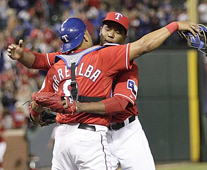 Yorvit Torrealba and Neftali Feliz embrace after Feliz nails down the save for Texas with a 1-2-3 ninth inning.  (AP)