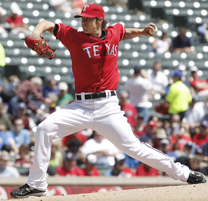 C.J. Wilson gets the win on the mound for the Rangers, allowing two earned runs and six hits in seven innings. (AP)