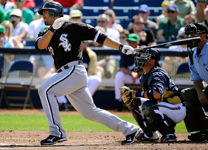 Carlos Quentin helps the White Sox to the extra-innings win with four hits, including a solo home run and a key double. (Getty Images)