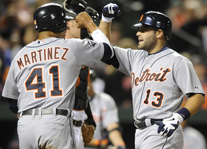 Alex Avila, right, is congratulated during a productive game in which he racks up a career-high five RBI. (AP)