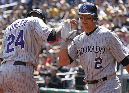 Troy Tulowitzki homers and drives in three runs as the Rockies ruin the Pirates' first home game under skipper Clint Hurdle. (AP)