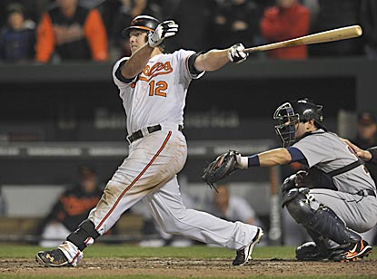 Mark Reynolds follows through on his two-run double during the Orioles' pivotal five-run seventh inning.  (AP)