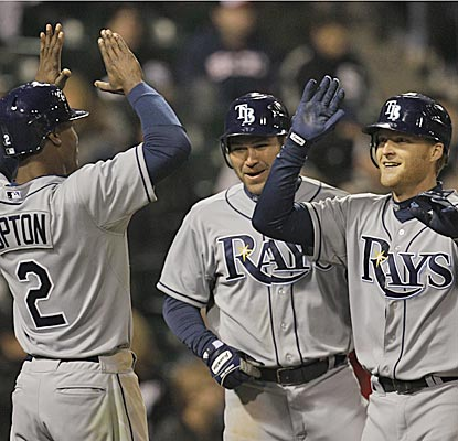 The Rays' Dan Johnson celebrates with B.J. Upton (left) and Johnny Damon after belting a three-run dinger in the ninth. (AP)