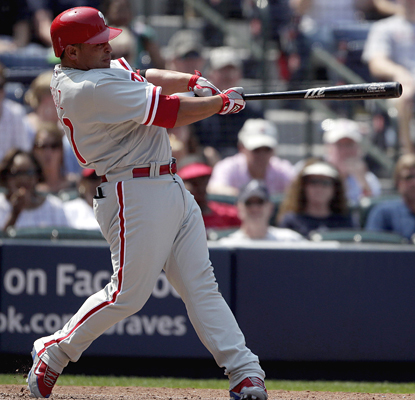 Carlos Ruiz connects on a pinch-hit grand slam in the seventh inning to help the Phillies bury the Braves. (AP)